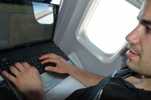 Alex blogging on the flight